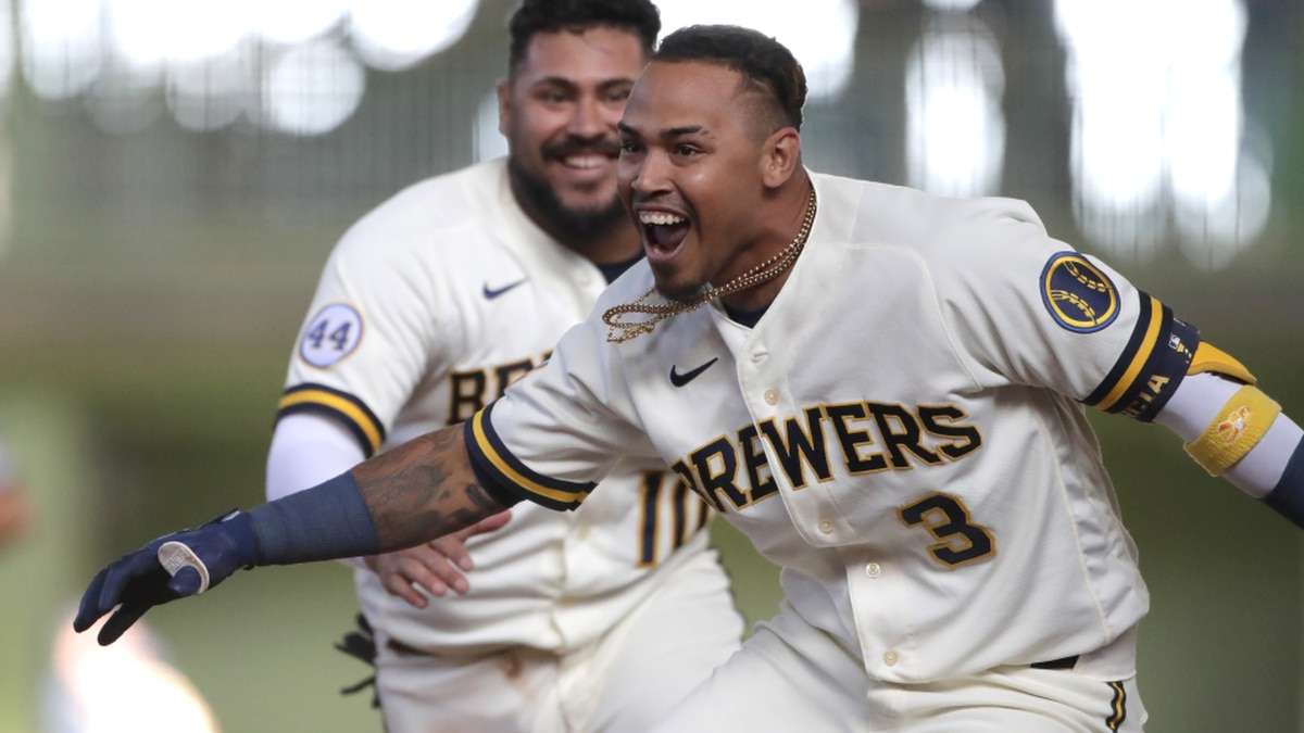 Milwaukee Brewers' Orlando Arcia celebrates with teammates after driving in the winning run...