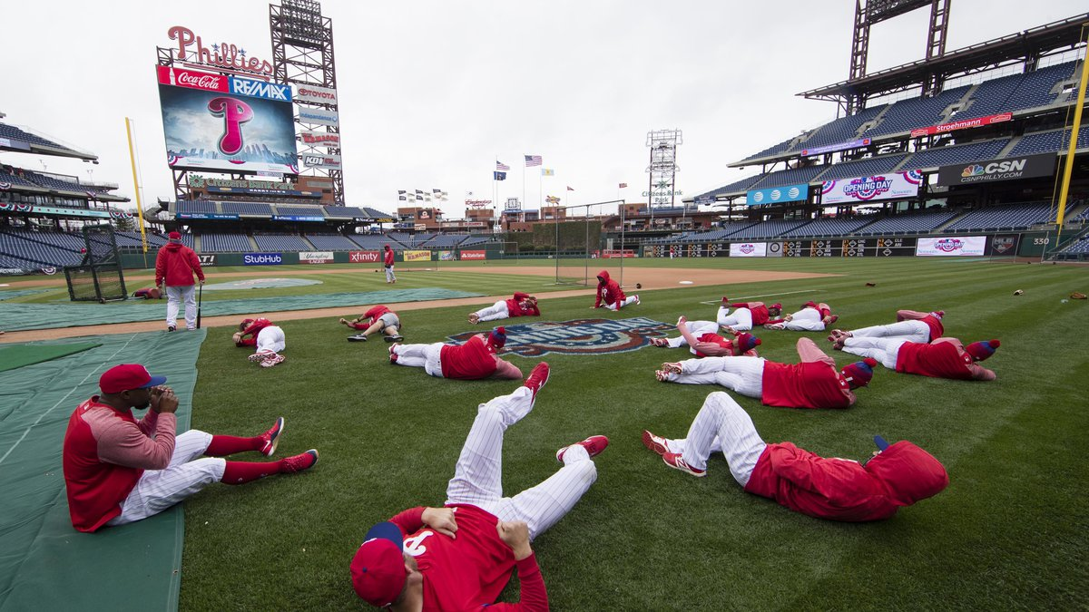 FILE - In this April 7, 2017, file photo, members of the Philadelphia Phillies stretch before...