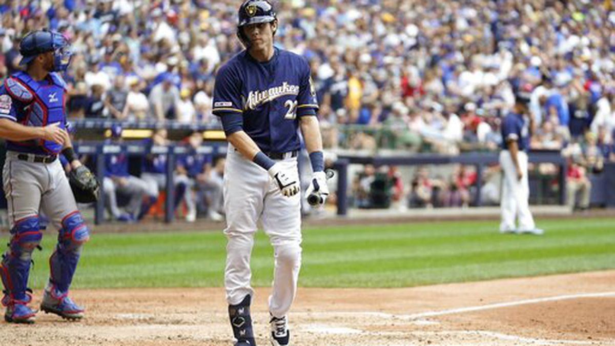Milwaukee Brewers' Christian Yelich reacts after striking out during the eighth inning of a baseball game against the Texas Rangers Sunday, Aug. 11, 2019, in Milwaukee. (AP Photo/Morry Gash)