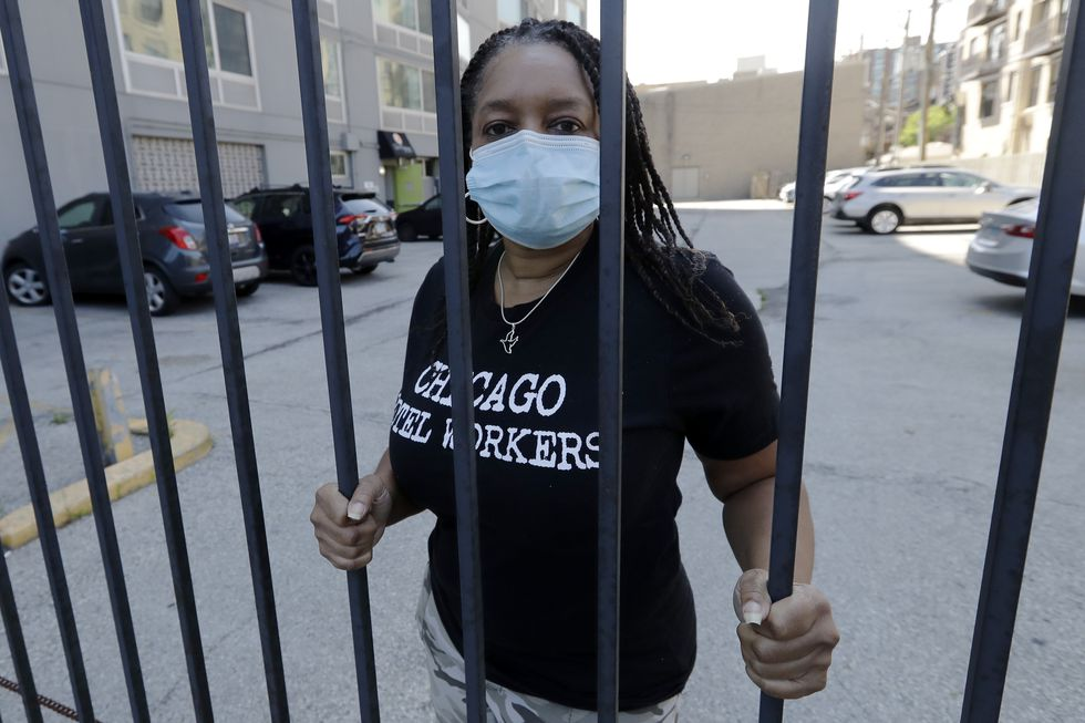 Roushaunda Williams poses for a photo in Chicago Thursday, July, 23, 2020. Financial challenges keep piling up for Williams months after she lost her job of nearly 20 years tending bar at the Palmer House Hilton Hotel in downtown Chicago. Potential reopening dates for the hotel have been pushed back, Williams said, and hospitality jobs remain scarce.