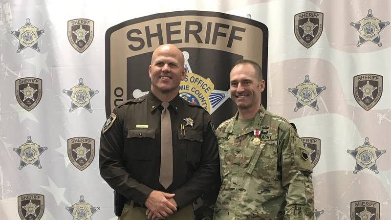 Outagamie County Sheriff Clint Kriewaldt poses with U.S. Army Col. Randy Southard, who is also...