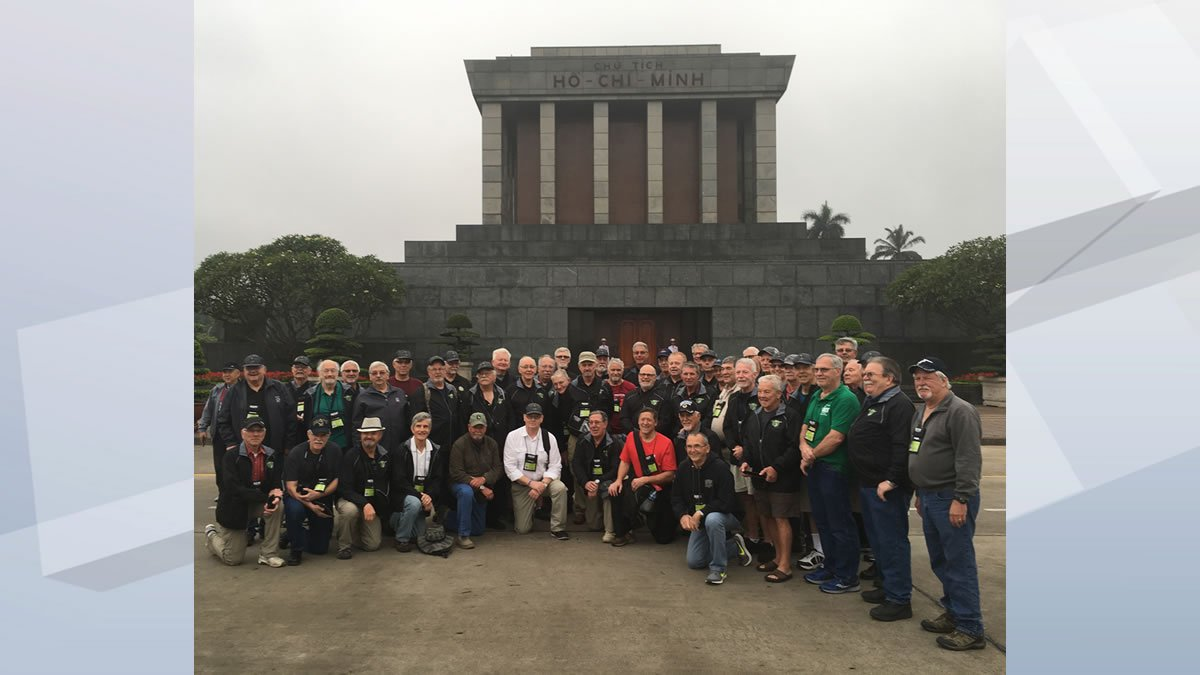 """Final group photo for the Old Glory Honor Flight """"Return to Nam,"""" taken in..."""