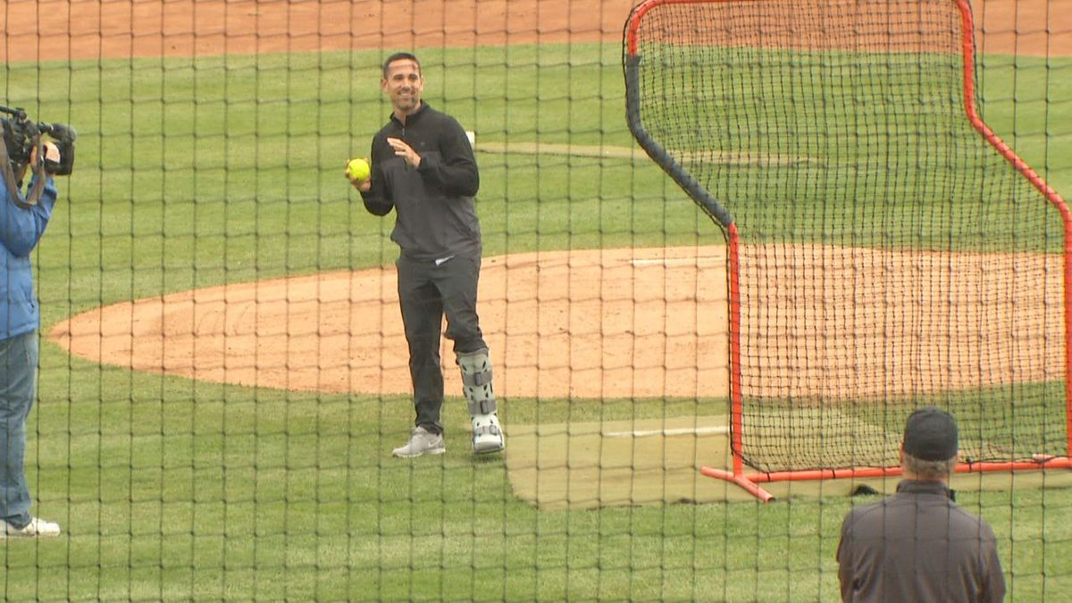 Packers Head Coach Matt LaFleur in a walking boot, throws out the first pitch at the 2019 Green and Gold Charity Softball game.