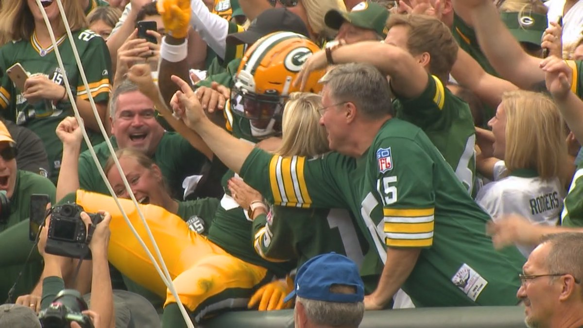 Packers fans celebrate during a home game at Lambeau Field in 2019.
