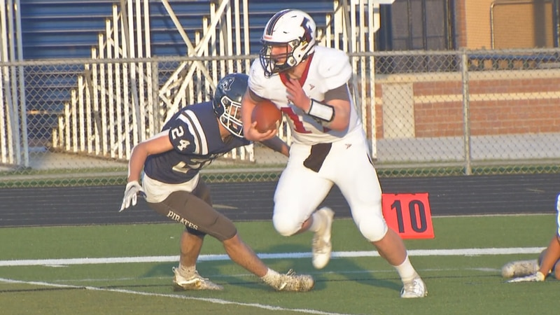 Fond du Lac senior quarterback Kyle Waljasper scores in Bay Port's 62-19 win on Friday night.