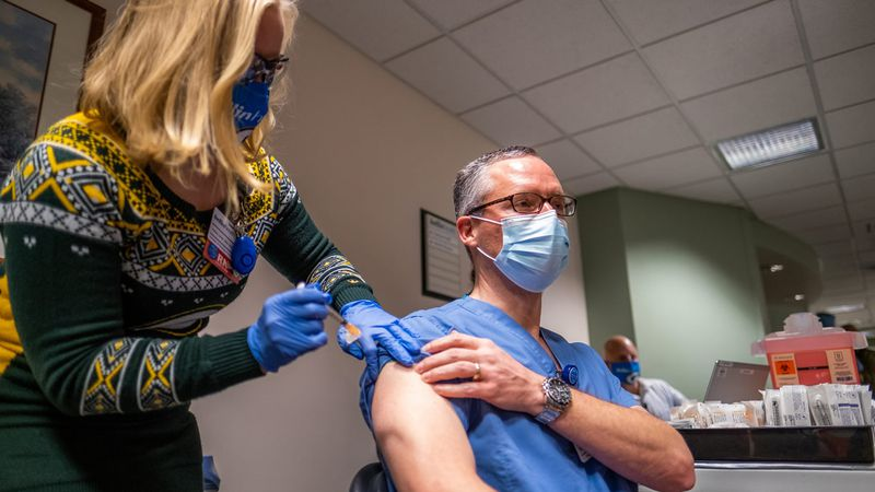 Bellin Health infectious disease specialist Dr. Michael Landrum receives the health system's...