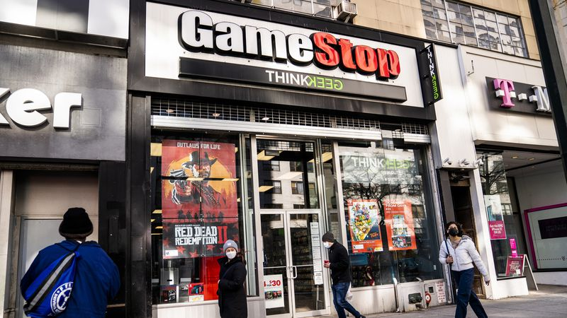 FILE - Pedestrians pass a GameStop store on 14th Street at Union Square, Thursday, Jan. 28,...