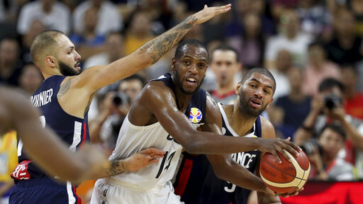 United States' Khris Middleton is blocked by French players during a quarterfinal match against United States for the FIBA Basketball World Cup in Dongguan in southern China's Guangdong province on Wednesday, Sept. 11, 2019. France defeats United States 89-79. (AP Photo/Ng Han Guan)