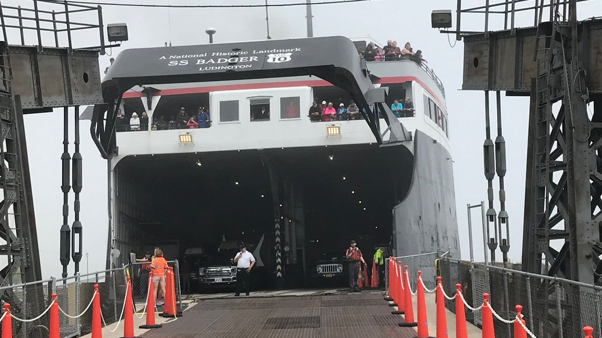 Passengers wait to disembark from the S.S. Badger in Manitowoc after its arrival from...