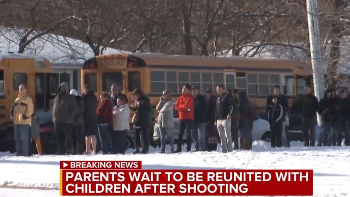 Parents wait to be reunited with Oshkosh West High School students bused to Perry Tipler Middle School (WBAY photo)