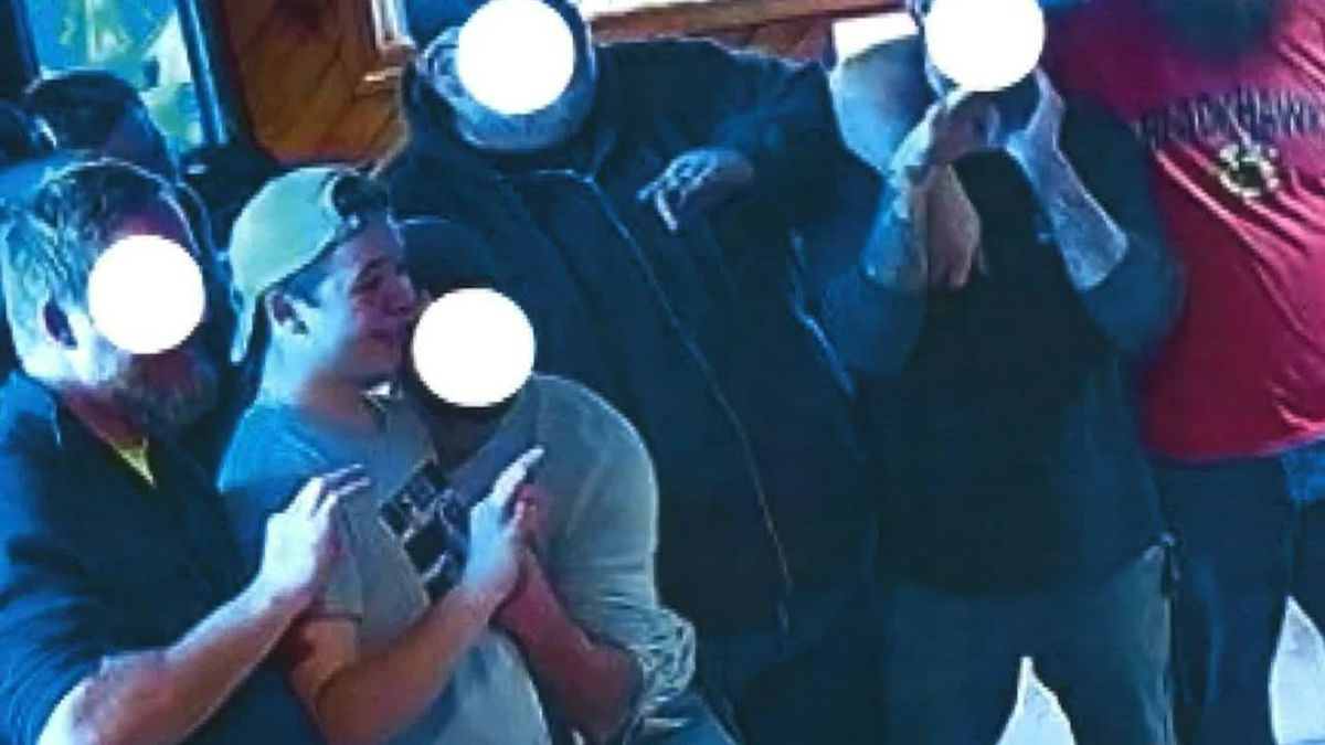 Kyle Rittenhouse is seen at a bar flashing what appears to be the white power sign. Prosecutors...