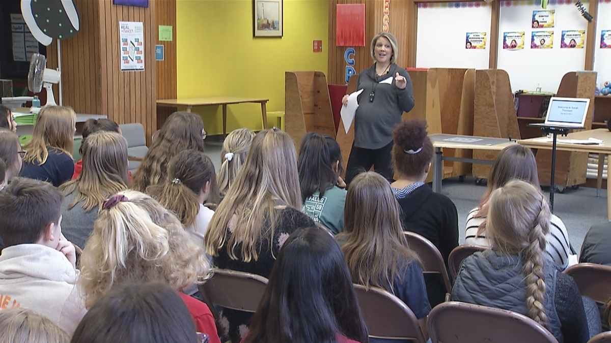 First Alert Investigative reporter/anchor Sarah Thomsen helps teach students at Shattuck Middle School in Neenah how to research and investigate tough topics.