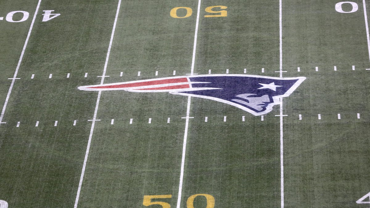 The gold 50 yard marker and Patriots logo is seen on the filed before the New England Patriots...