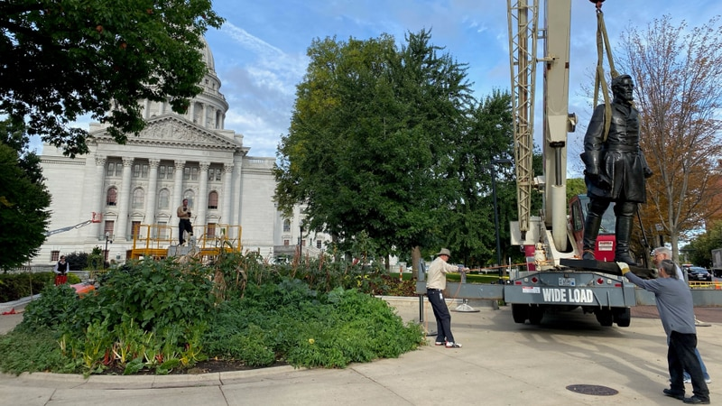 """Crews work to restore the """"Forward"""" statue and the one of Col. Hans Christian Heg, which were..."""