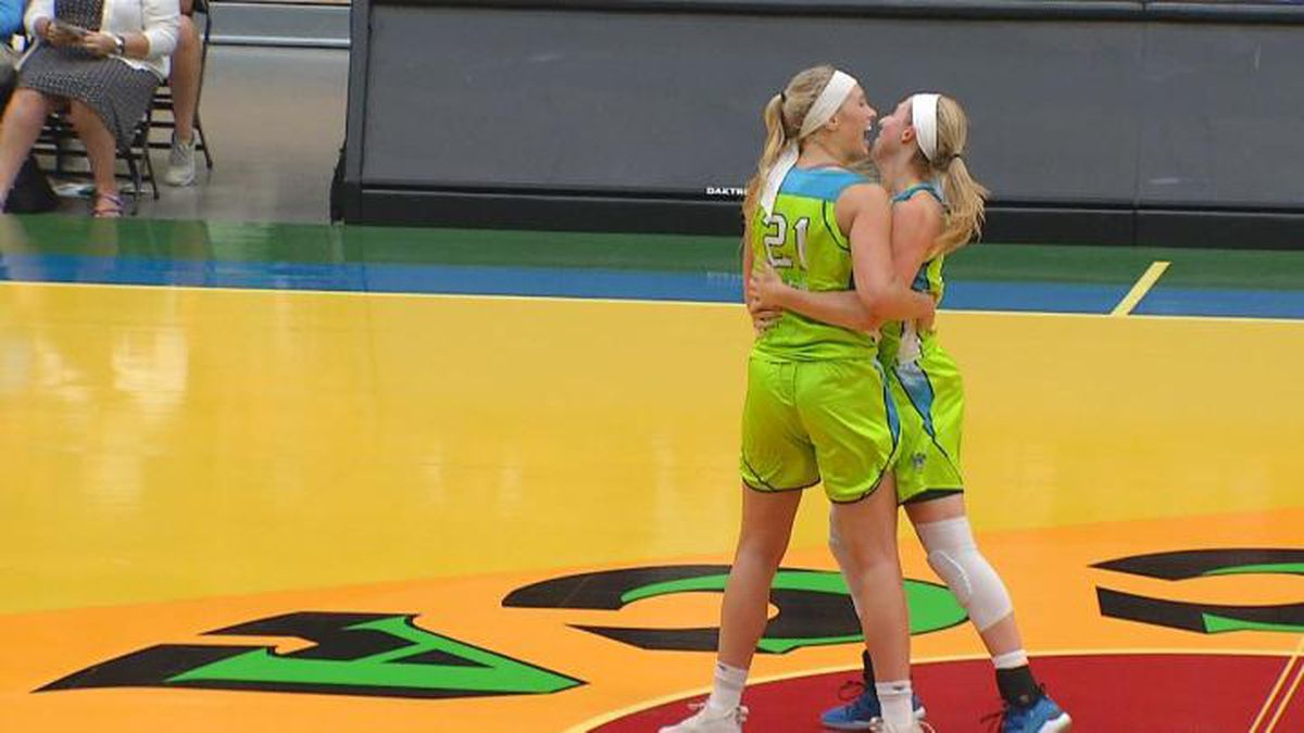 Wisconsin GLO forward Jessica Lindstrom and guard Allie LeClaire celebrate after the team's 99-79 win against the Flint Monarchs on Saturday, July 13 in Oshkosh.