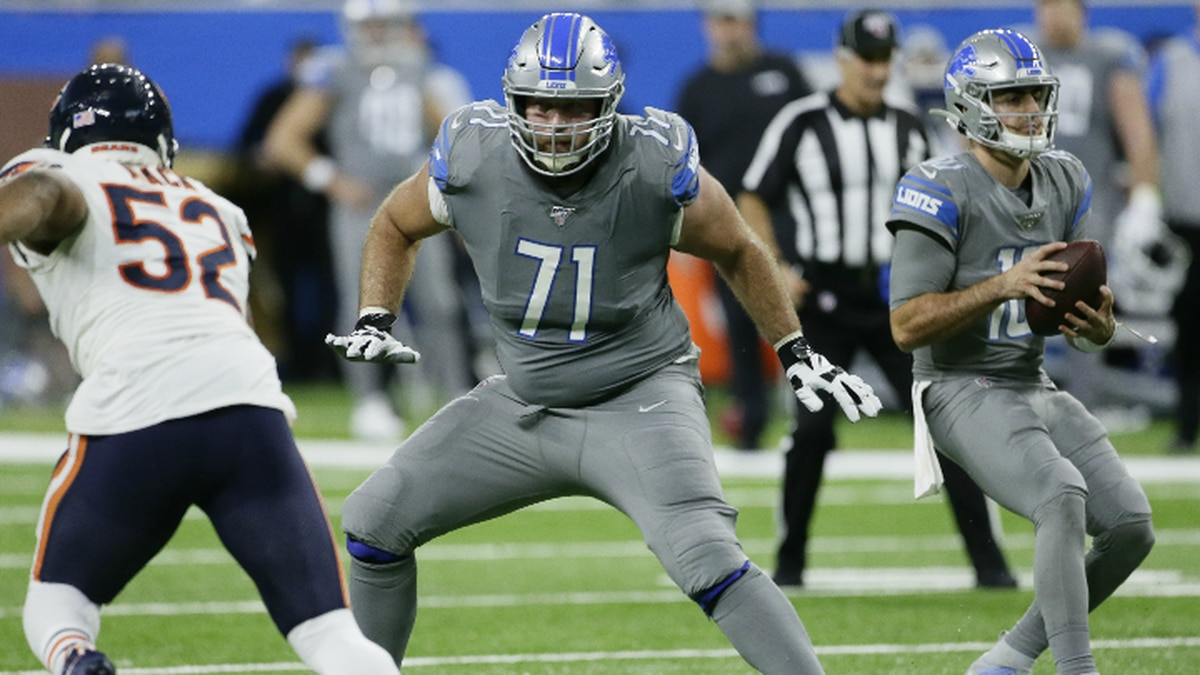 Detroit Lions offensive tackle Rick Wagner (71) defends quarterback David Blough, right, against Chicago Bears outside linebacker Khalil Mack (52) during the second half of an NFL football game, Thursday, Nov. 28, 2019, in Detroit. (AP Photo/Duane Burleson)