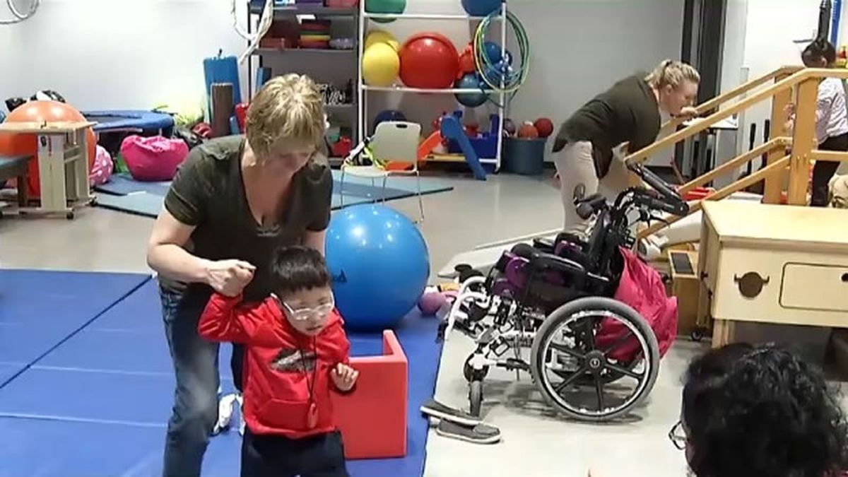 Helping young clients in the new CP facility in Allouez (WBAY photo)