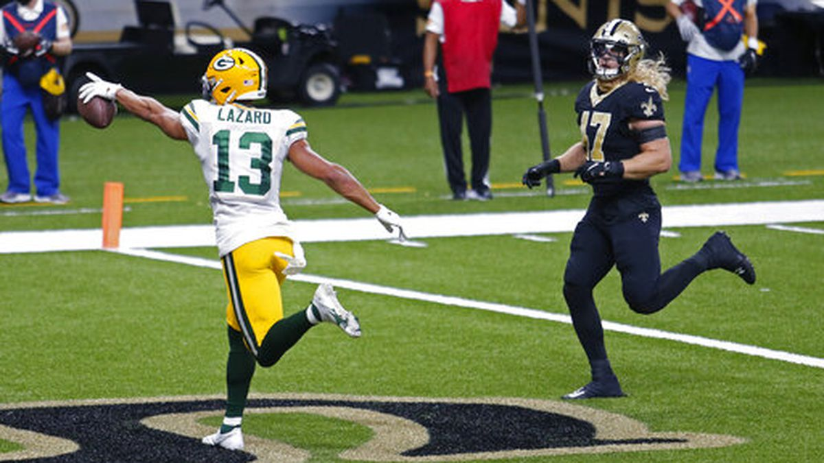 Green Bay Packers wide receiver Allen Lazard (13) gestures after a touchdown reception against New Orleans Saints middle linebacker Alex Anzalone (47) in the first half of an NFL football game in New Orleans, Sunday, Sept. 27, 2020. (AP Photo/Brett Duke)