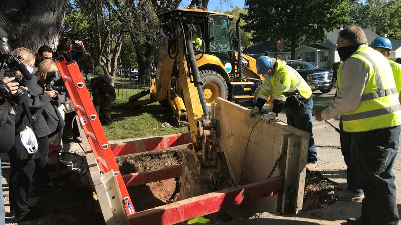 Green Bay Water Utility crews remove a lead pipe on Emilie Street