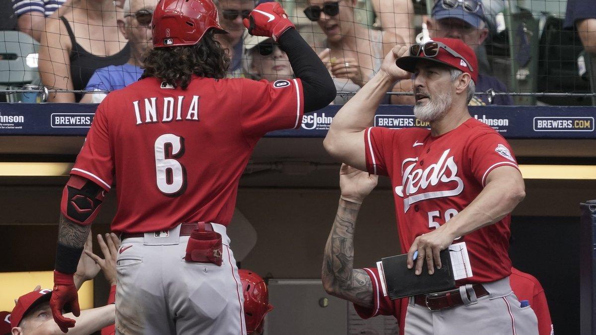 Cincinnati Reds hitting coach Alan Zinter congratlates Jonathan India on his three-run home run...