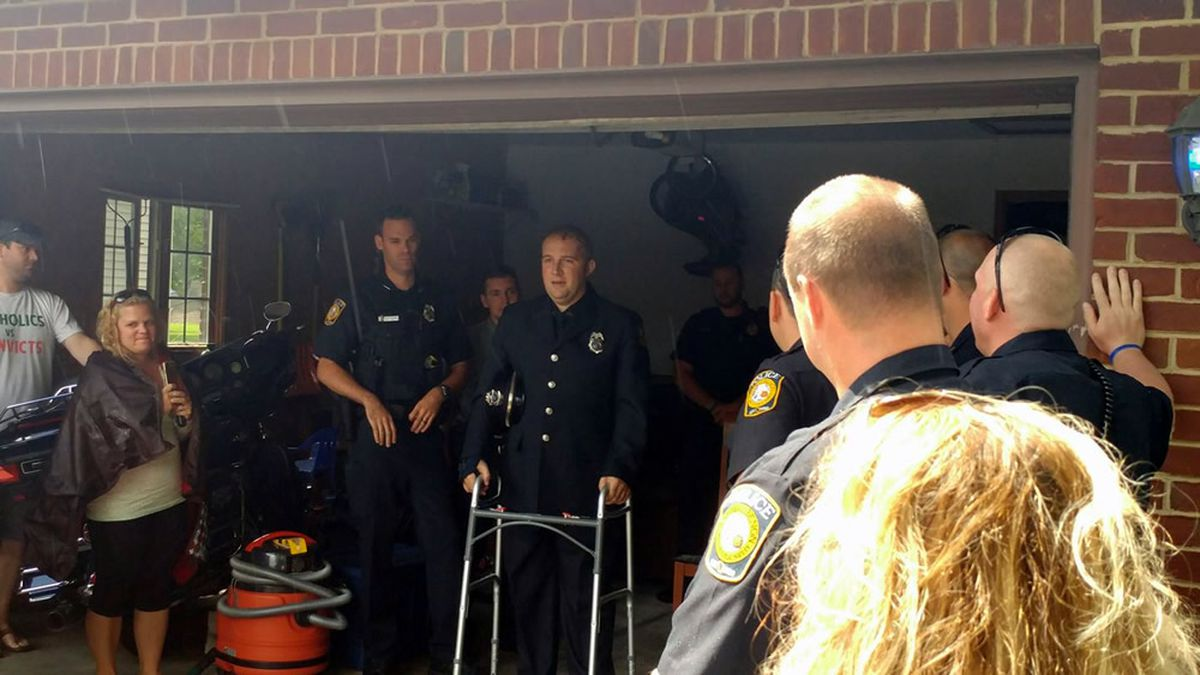 Officer Brian Murphy is surrounded by friends at his home after his release from the hospital (photo provided)