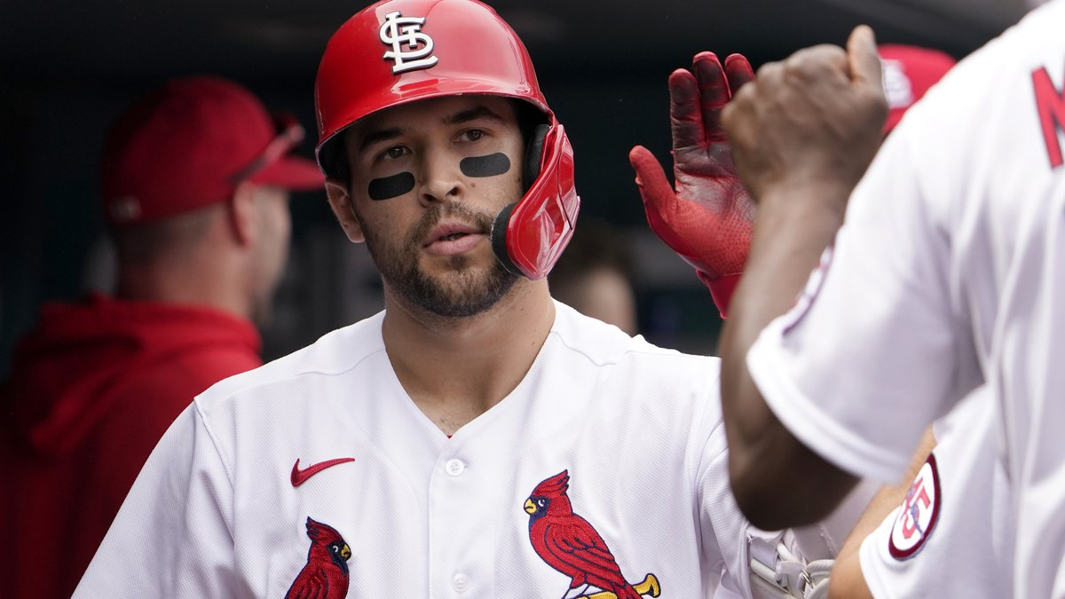 St. Louis Cardinals' Dylan Carlson is congratulated by teammates after hitting a solo home run...