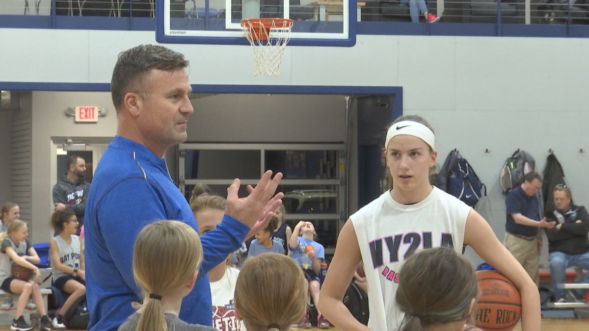 Owner of The Driveway, Ryan Borowicz, talks to basketball players at the end of practice.