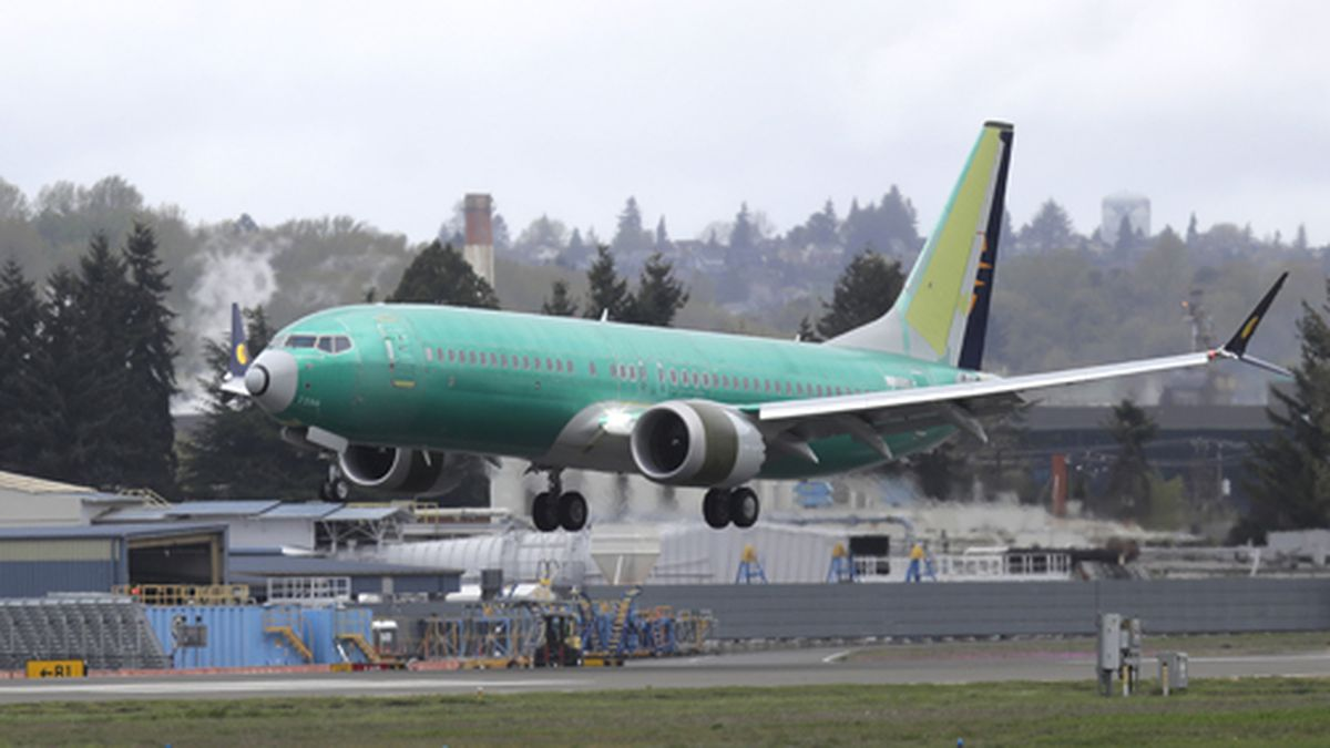 In this April 10, 2019 photo, a Boeing 737 Max 8 airplane being built for India-based Jet Airways lands following a test flight at Boeing Field in Seattle. Boeing and the Federal Aviation Administration are both partly at fault for the failures of the 737 Max, the plane model involved in two fatal crashes, according to a new report. The New York Times said Friday, Oct. 11,  that a multiagency task force found that Boeing didn't appropriately explain the plane's new automated system to regulators, and the FAA didn't have the capability to effectively analyze much of what Boeing did share about the plane. (AP Photo/Ted S. Warren, File)