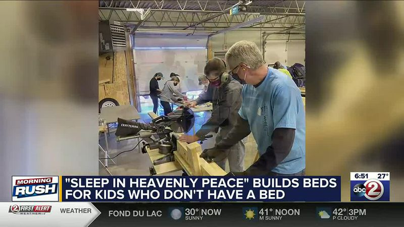 Volunteers build beds for children