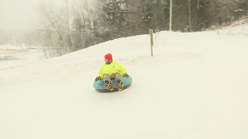 Some goes snow tubing from a hill at Winter Park in Kewaunee.
