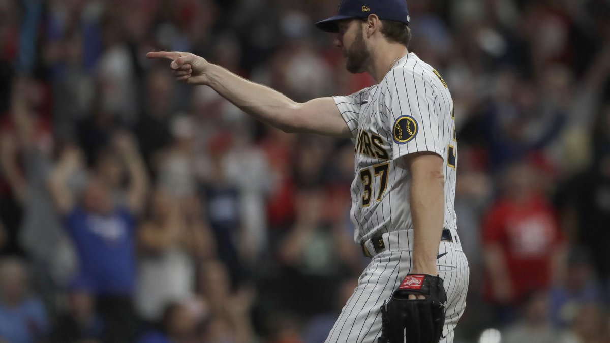Milwaukee Brewers' Adrian Houser gestures after throwing a complete baseball game shutout...