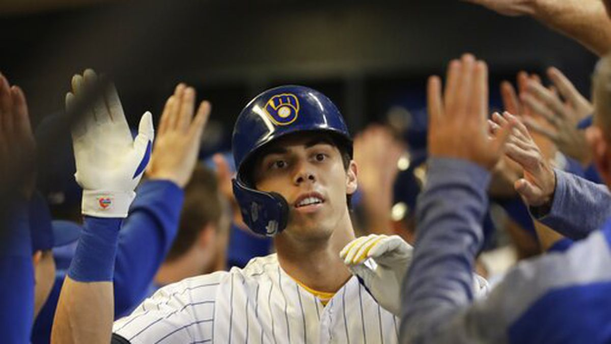 Milwaukee Brewers' Christian Yelich is congratulated after hitting a three-run home run during the third inning of a baseball game against the Chicago Cubs Friday, Sept. 6, 2019, in Milwaukee. (AP Photo/Morry Gash)
