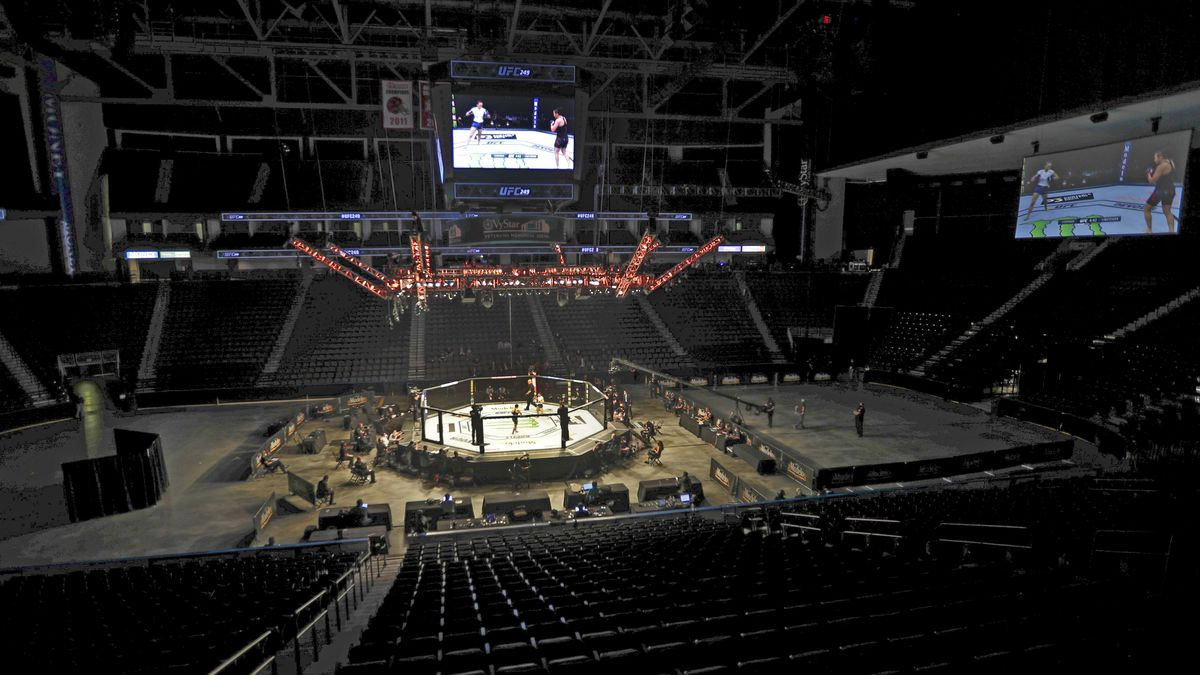 Fighters battle without spectators during a UFC 249 mixed martial arts bout, Saturday, May 9,...