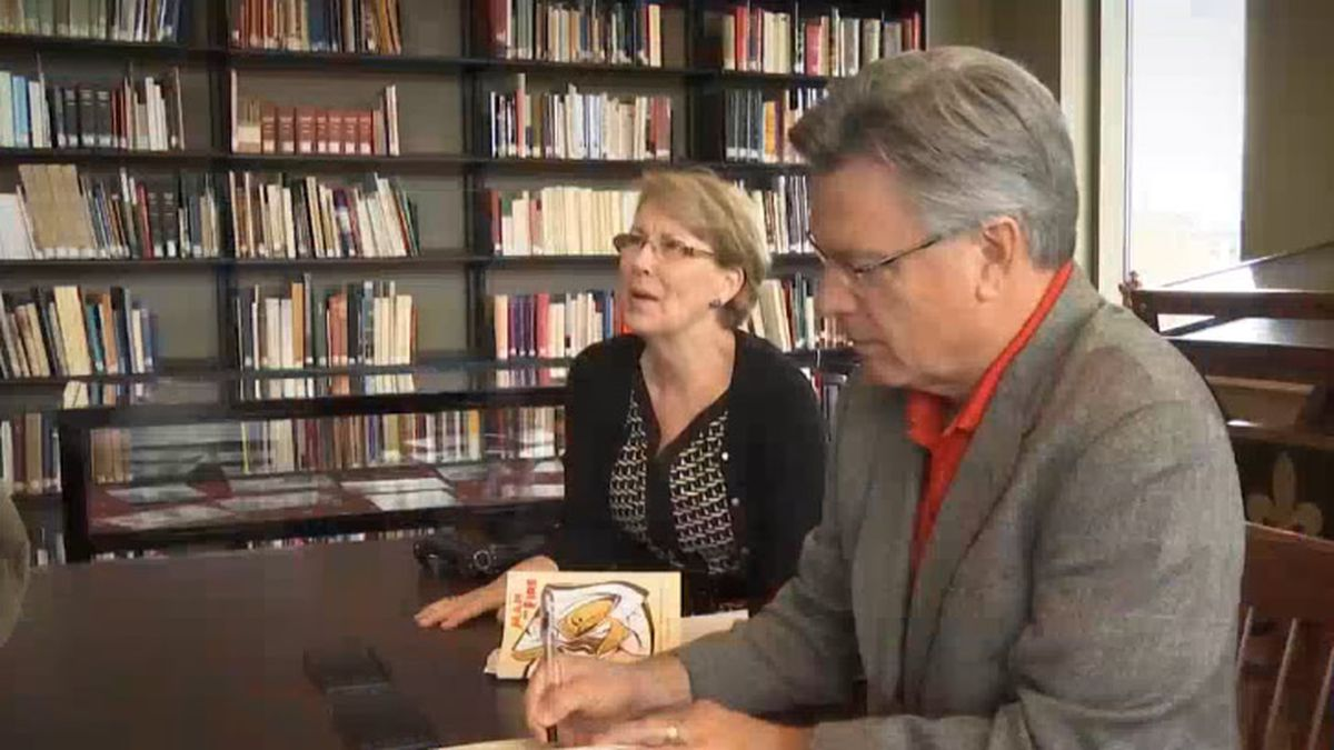 "Former St. Norbert College president Thomas Kunkel at a book signing for ""Man on Fire,"" about the life of the college's namesake (WBAY photo)"