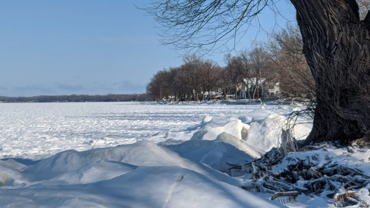 The snow- and ice-covered Bay of Green Bay, seen from shore (WBAY photo)