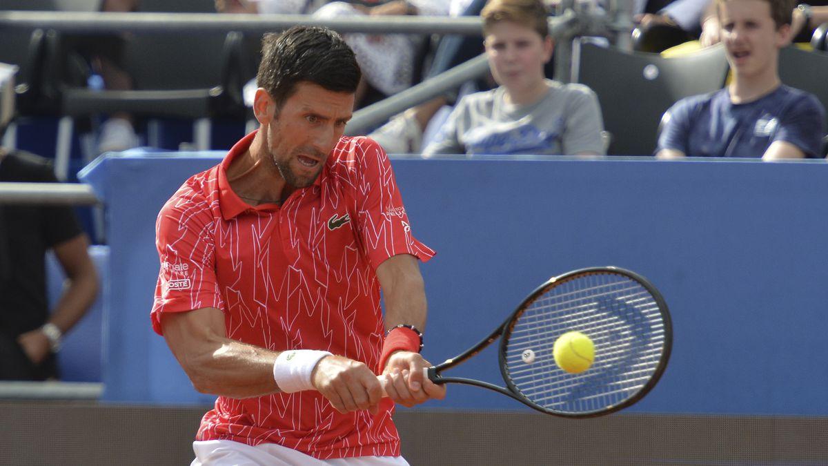 Serbia's Novak Djokovic returns the ball during an exhibition tournament in Zadar, Croatia, Sunday, June 21, 2020.