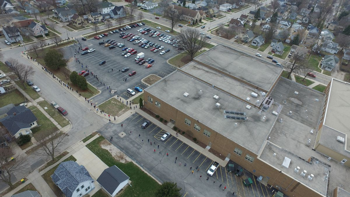 The First Alert Drone captures a line of voters waiting to cast a ballot at Green Bay West High...