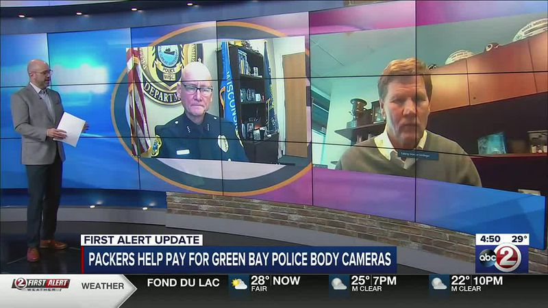 Chris Roth interviews Green Bay Police Chief Andrew Smith (left) and Packers president/CEO Mark...