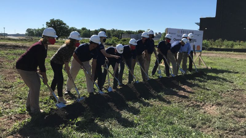 Ariens employees breaking ground