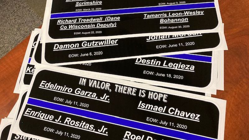 More than three dozen stickers, bearing the names of fallen officers, are printed on stickers...