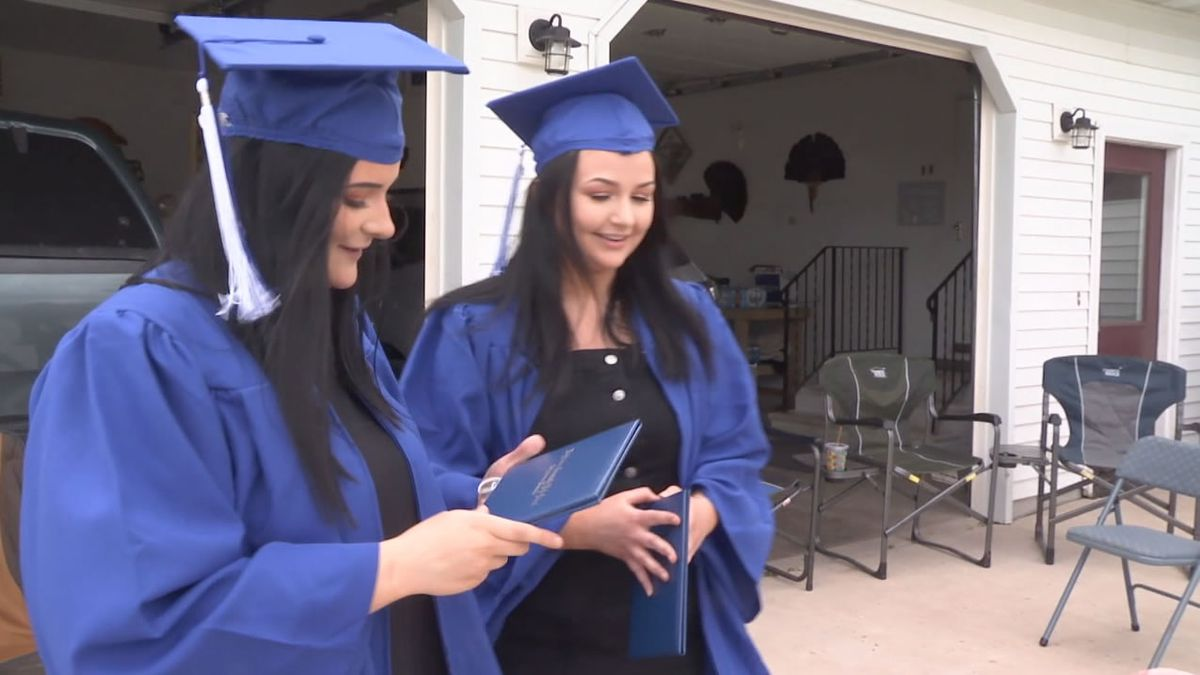 Wrightstown High School principal Scott Thompson (not pictured) delivered diplomas to graduates personally in driveway ceremonies on May 22, 2020 (WBAY photo)