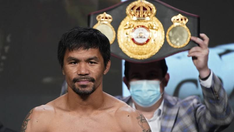 FILE - In this Aug. 20, 2021 file photo, Manny Pacquiao, of the Philippines, poses for...