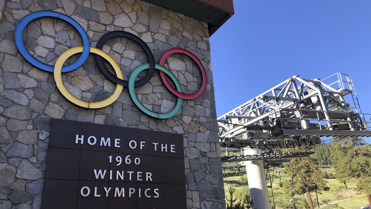 A sign marking the 1960 Winter Olympics is seen by a chairlift at Squaw Valley Ski Resort in Olympic Valley, Calif., July 9, 2020. The ski resort is changing its name to remove a derogatory term for Native American women.