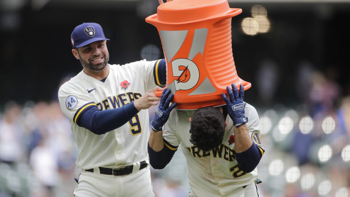 Milwaukee Brewers' Luis Urias, right, is congratulated by Manny Pina, left, after hitting a...