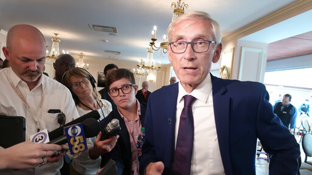 FILE - In this Sept. 24, 2019, file photo, Wisconsin Gov. Tony Evers speaks with reporters at...