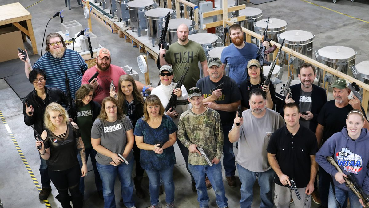 BenShot employees holding handguns they received from the company for Christmas (photo provided)