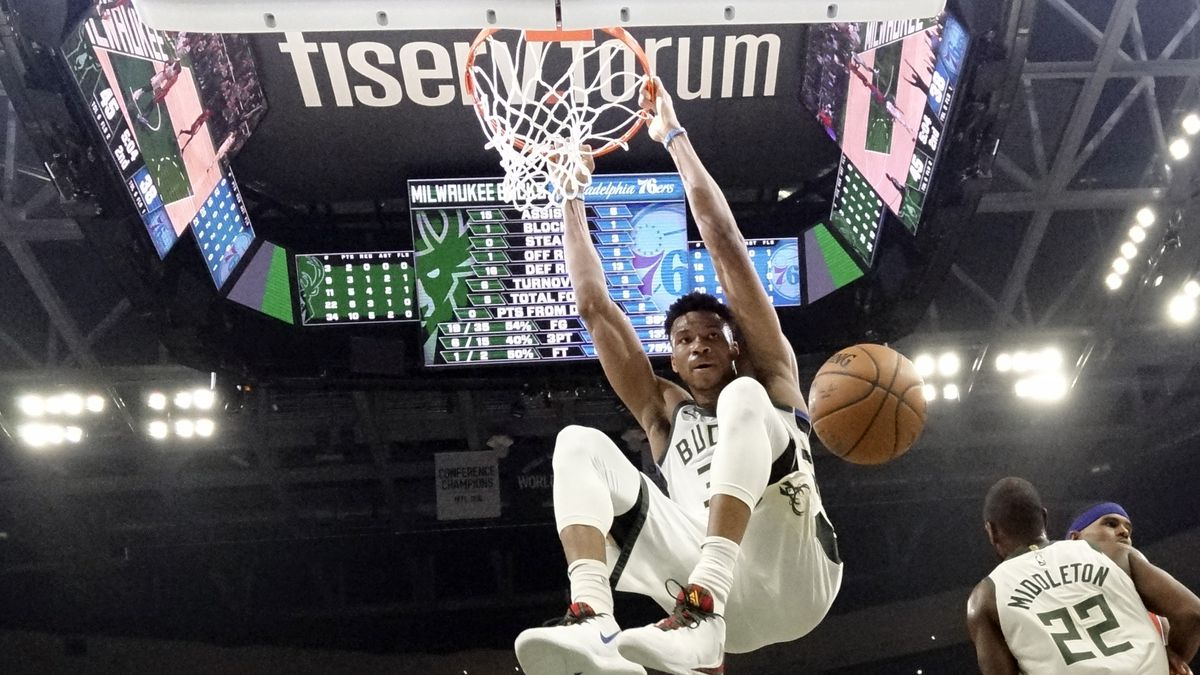 In this Feb. 22, 2020, file photo, Milwaukee Bucks' Giannis Antetokounmpo dunks during the first half of an NBA basketball game against the Philadelphia 76ers in Milwaukee. The Bucks believe they can build on the momentum they established while producing the NBA's best record before the pandemic-imposed hiatus.