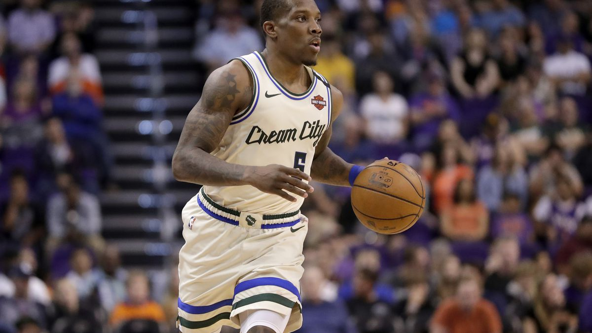 Milwaukee Bucks guard Eric Bledsoe (6) moves the ball up court against the Phoenix Suns during the second half of an NBA basketball game Sunday, March 8, 2020, in Phoenix. (AP Photo/Matt York)