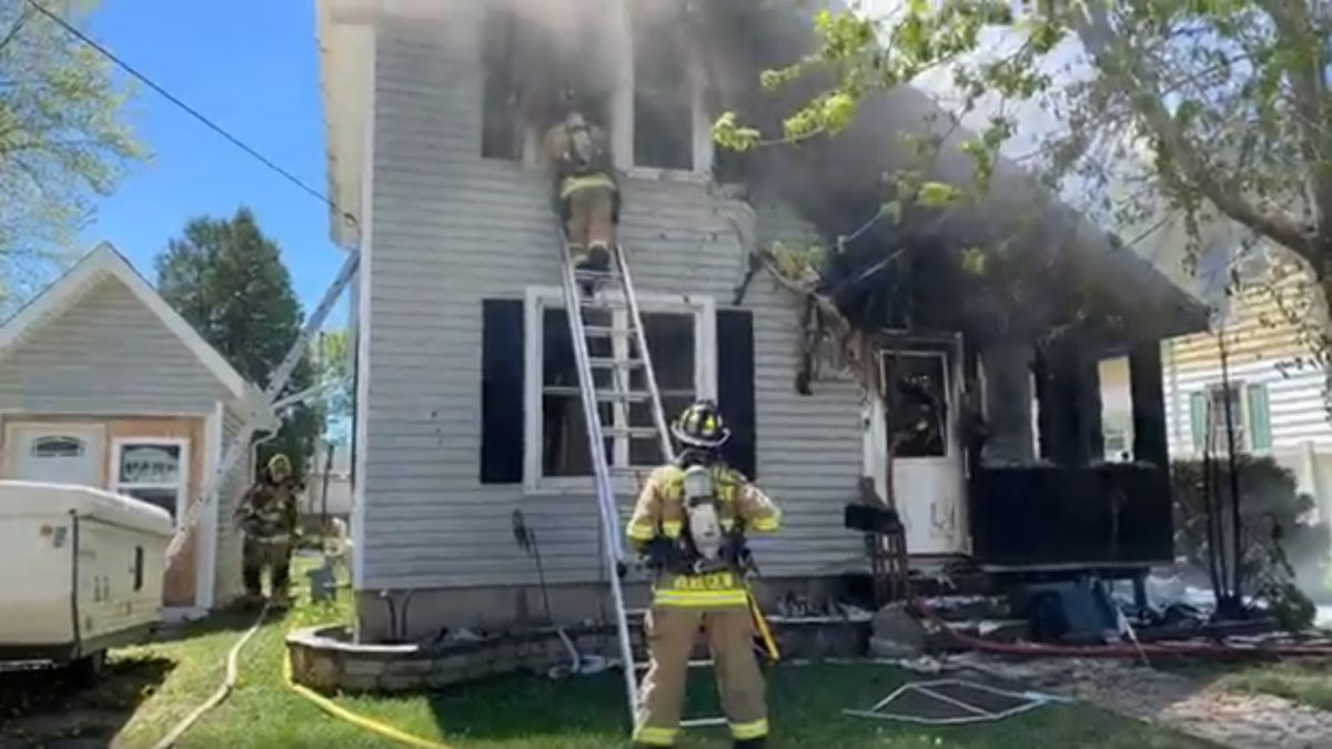 Fond du Lac firefighters extinguish a house fire on Central Ave. on May 21, 2020 (screenshot from Fond du Lac Fire & Rescue video)