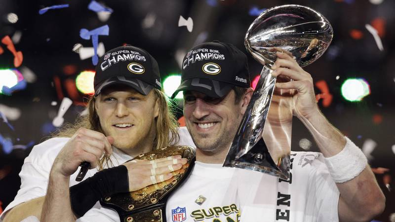 FILE - In this Feb. 6, 2011, file photo, Green Bay Packers' Aaron Rodgers, right, and Clay...
